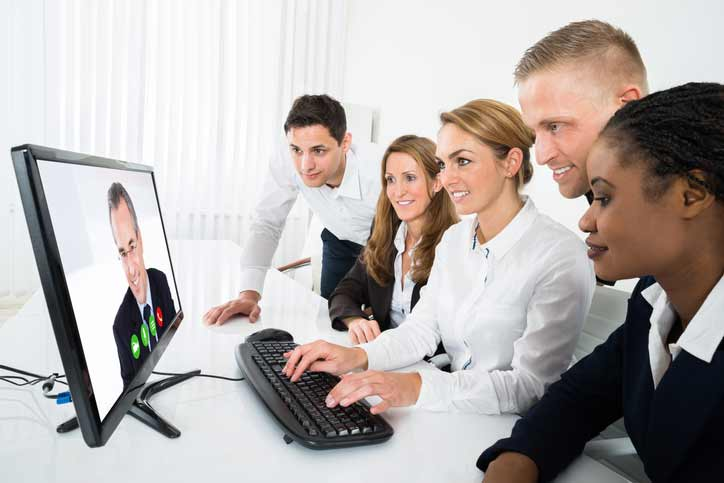 An online French group course in a company. A small group of employees are learning French via video conference.