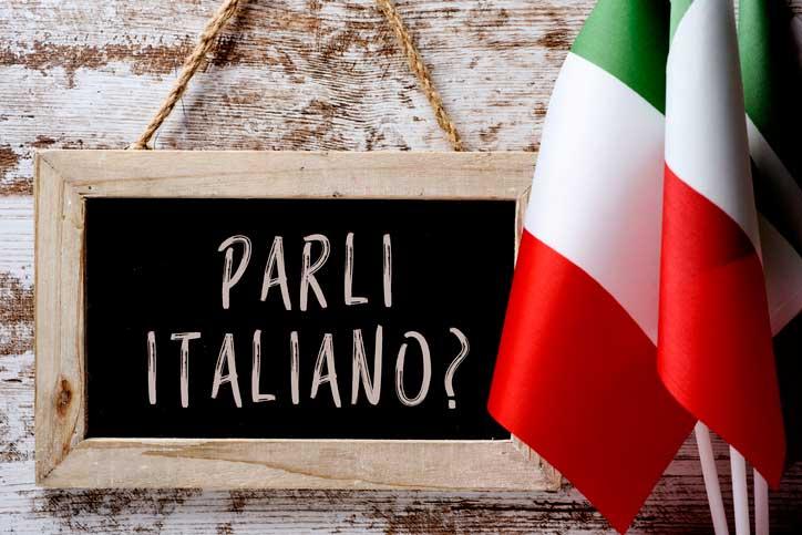 """On a tablet i t says """"Parli italiano?"""", Do you speak Italian?"""